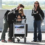 Christian And Family Arriving At Heathrow Airport [May 3, 2011]