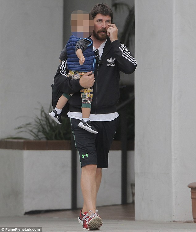 34091BEE00000578-3584451-Christian_Bale_was_the_archetypal_doting_dad_on_Tuesday_as_he_sp-m-22_1462959134489
